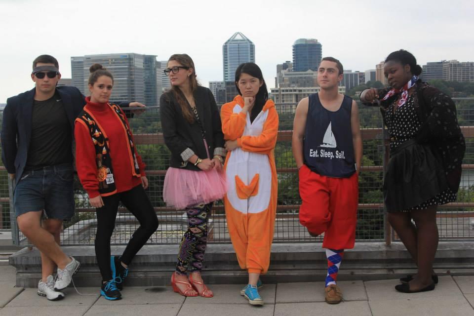 (l-r) DJ: jorts ($0, homemade), blazer ($500.01, J. Crew), gym shoes ($?); Catherine: Halloween vest ($5, Party City), sneakers ($89.99, Nike©Just Do It); Sara: blazer ($500.02, J. Crew), tutu ($9, WalMart), leggings ($6, Hot Topic); Emily: animal-themed loungewear ($25, Ebay); Max: pinnie ($0, the State of Rhode Island), golf knickers ($90, Golfsmith), socks ($3, Georgetown bookstore); Alexis: American flag ($17.76, America), smize (priceless)